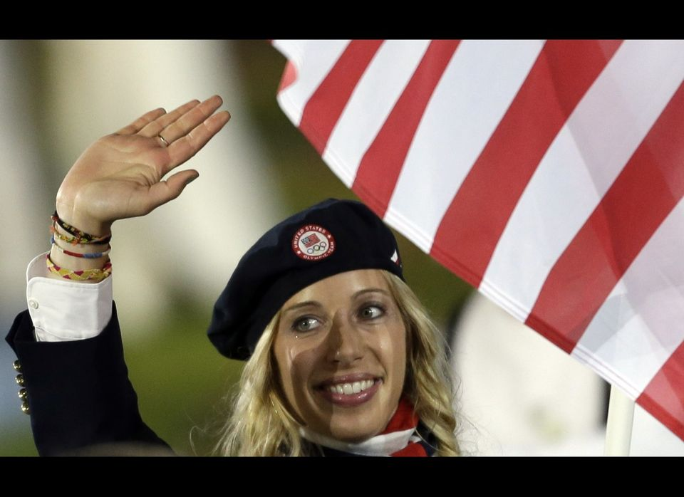 United States's Mariel Zagunis carries the flag during the Opening Ceremony at the 2012 Summer Olympics, Friday, July 27, 201