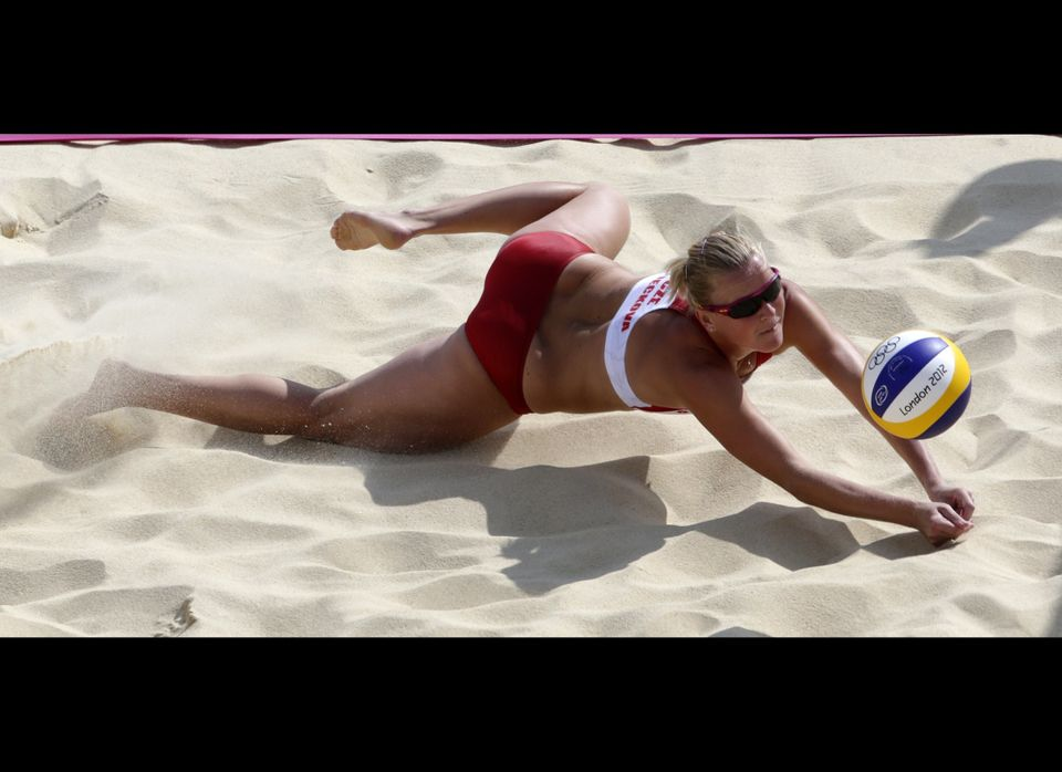 Lenka Hajeckova of the Czech Republic dives the ball in a match against Germany in the Beach Volleyball competition at the 20