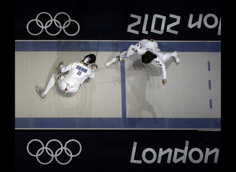 South Korea's Shin A-lam and Germany's Britta Heidemann compete during a women's individual epee fencing semifinals match aga