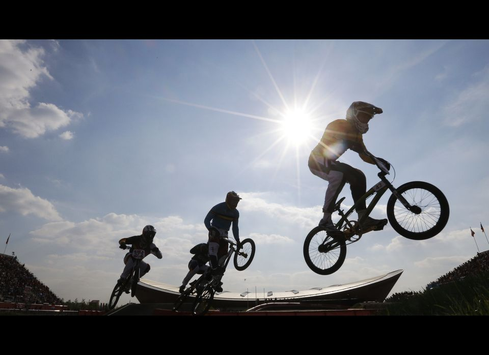 Australia's Brian Kirkham, right, leads cyclists while competing in a BMX cycling men's quarterfinal run at the 2012 Summer O