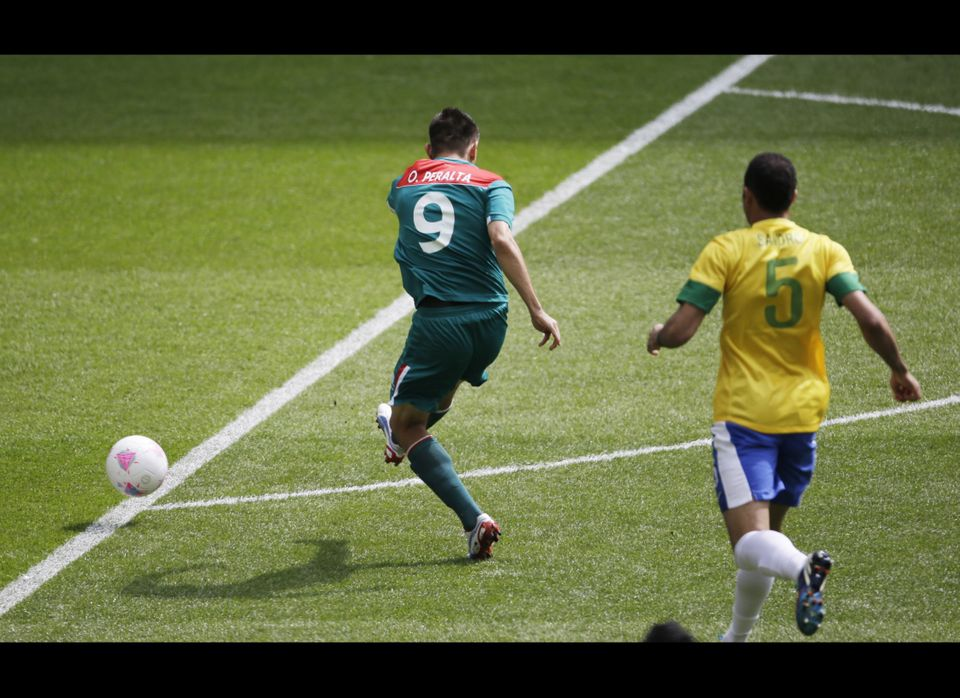 Mexico's Oribe Peralta (9) controls the ball ahead of Brazil's Sandro (5) during the men's soccer final at the 2012 Summer Ol