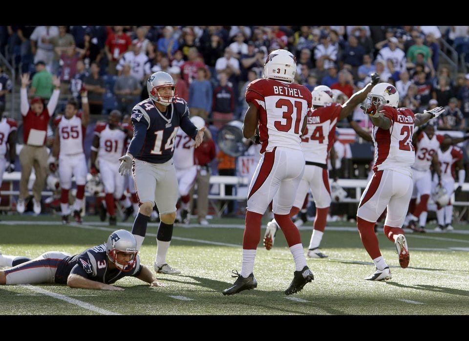 New England Patriots kicker Stephen Gostkowski (3) lies on the field alongside Arizona Cardinals cornerback Justin Bethel (31