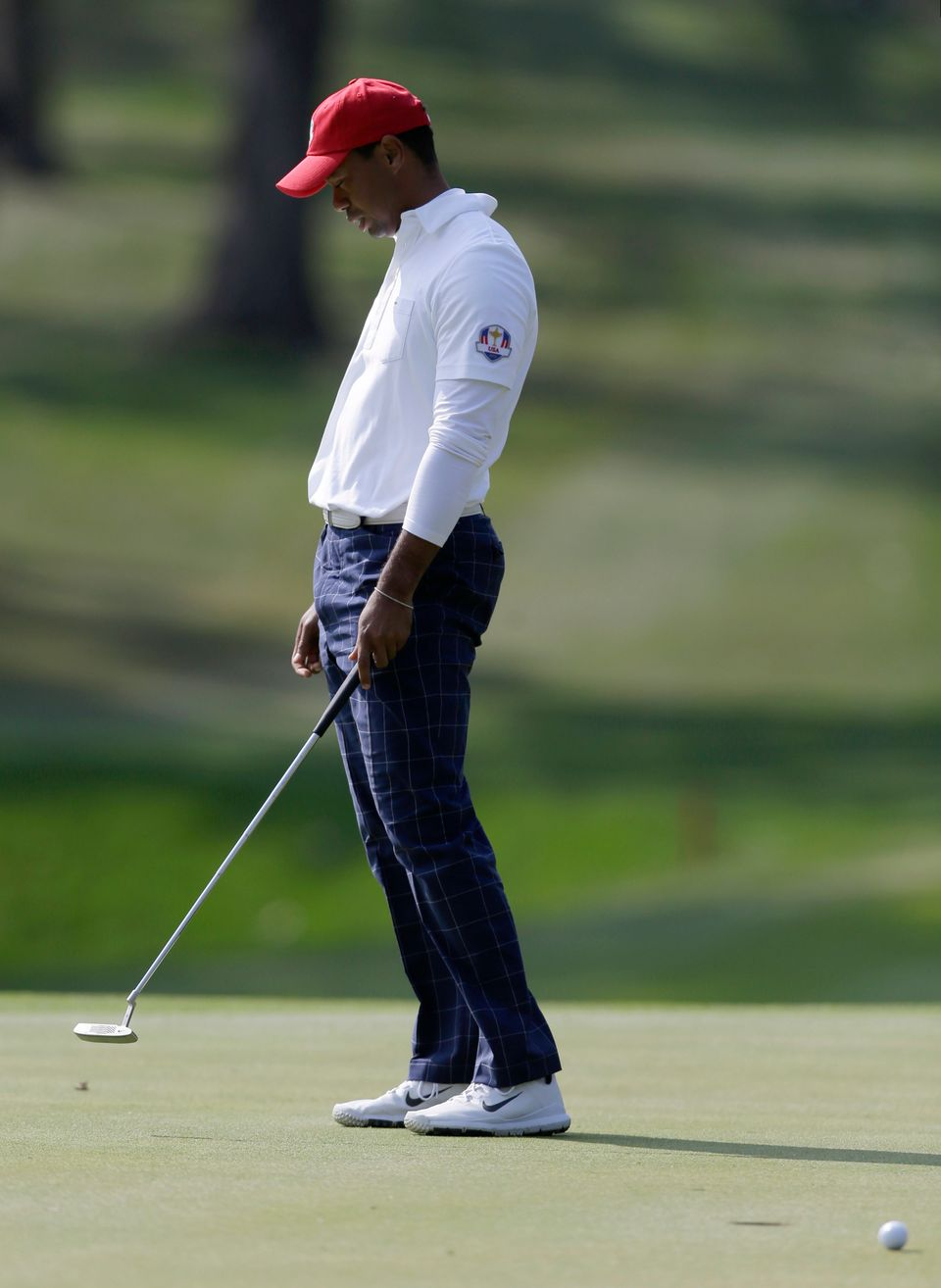 USA's Tiger Woods reacts after missing a putt on the 12th hole during a foursomes match at the Ryder Cup PGA golf tournament