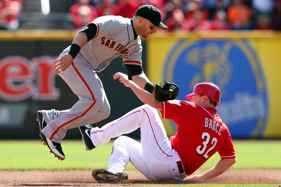 Marco Scutaro #19 of the San Francisco Giants tags out Jay Bruce #32 of the Cincinnati Reds at second base in Game Five of th
