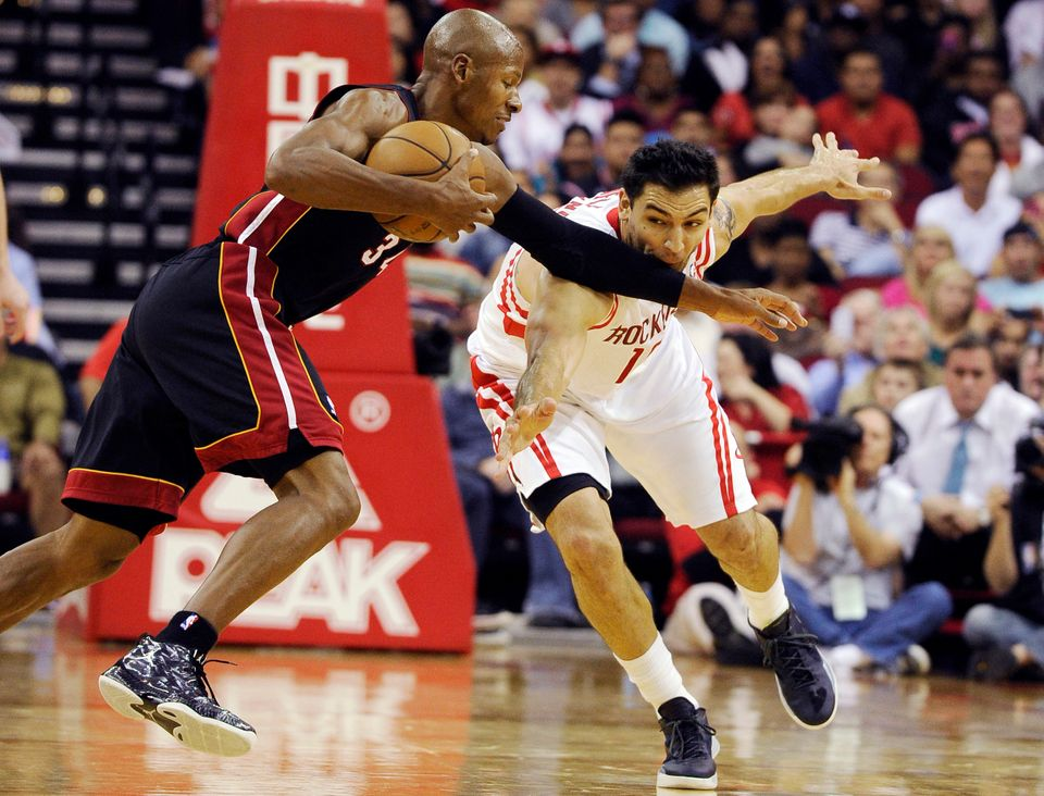 Miami Heat's Ray Allen (34) keeps Houston Rockets' Carlos Delfino (10) away from the ball in the second half of an NBA basket