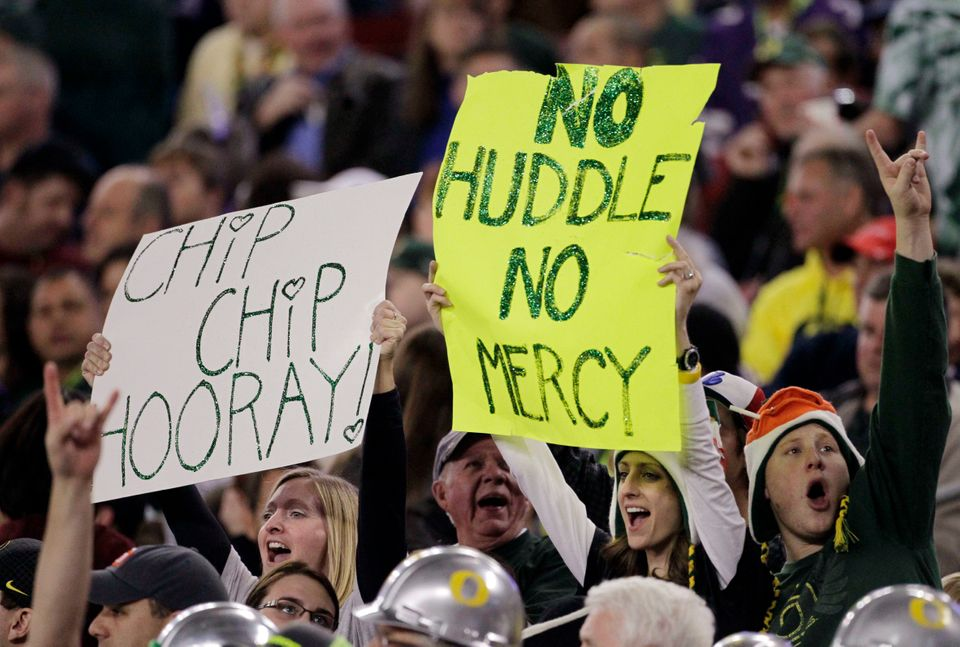 Oregon fans cheer against Kansas State during the first half of the Fiesta Bowl NCAA college football game, Thursday, Jan. 3,
