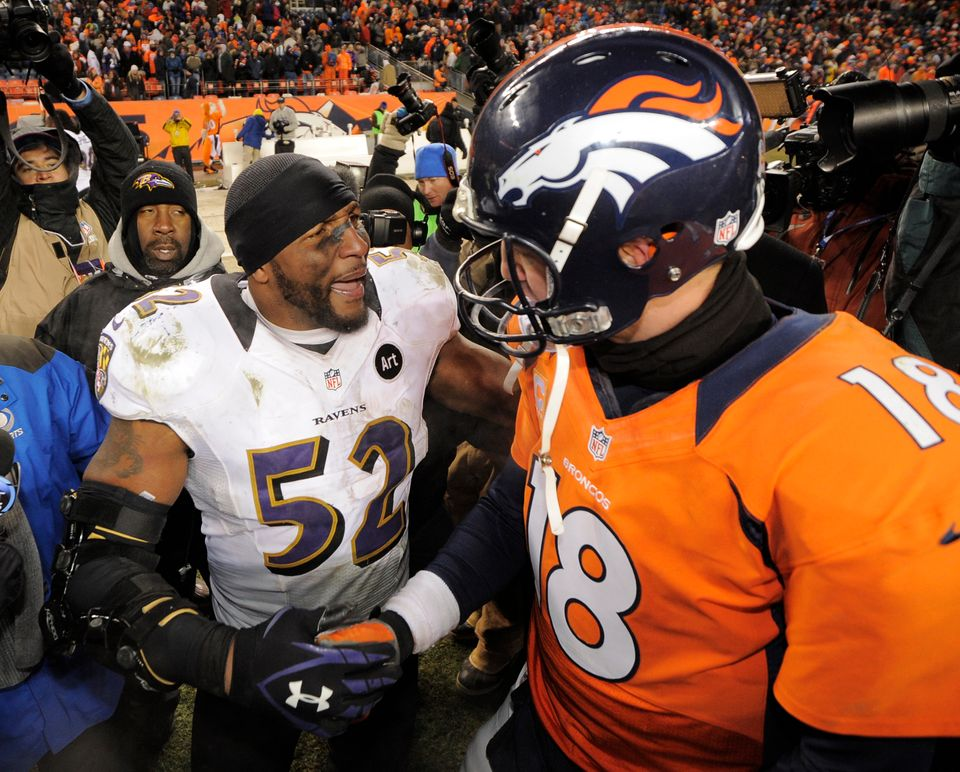 Baltimore Ravens inside linebacker Ray Lewis shakes hands Denver Broncos quarterback Peyton Manning (18) after the Ravens won