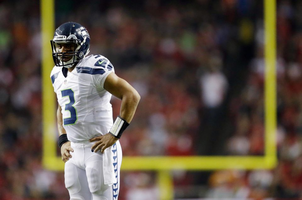 Seattle Seahawks quarterback Russell Wilson (3) watches play against the Atlanta Falcons during the second half of an NFC div