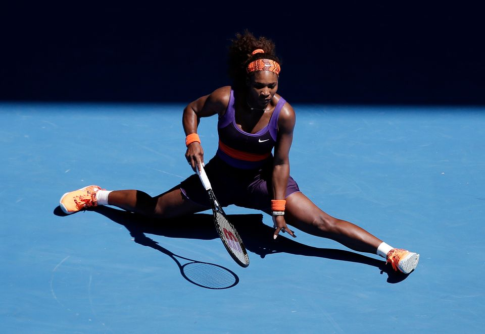 Serena Williams of the US slides to a stop after hitting a return during her quarterfinal match against compatriot Sloane Ste
