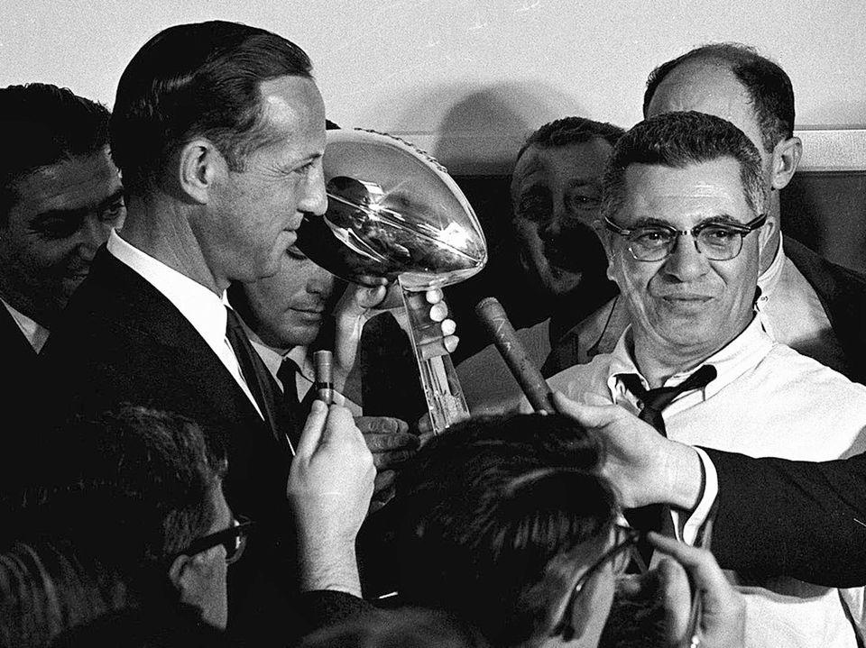 JAN. 15, 1967 (Los Angeles Memorial Coliseum, Los Angeles) -- Commissioner Pete Rozelle, left, presents the trophy to Green B