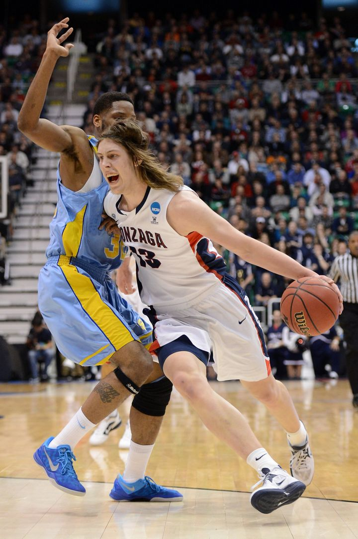 SALT LAKE CITY, UT - MARCH 21:  Kelly Olynyk #13 of the Gonzaga Bulldogs with the ball against Brandon Moore #32 of the South