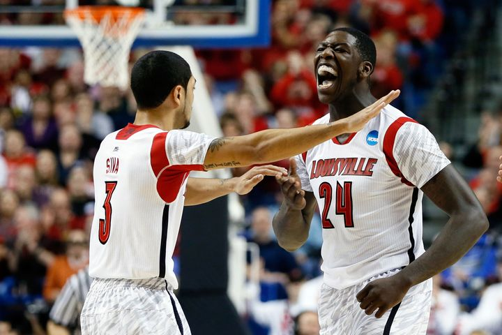LEXINGTON, KY - MARCH 21:  Montrezl Harrell #24 of the Louisville Cardinals celebrates with Peyton Siva #3 after a turnover a