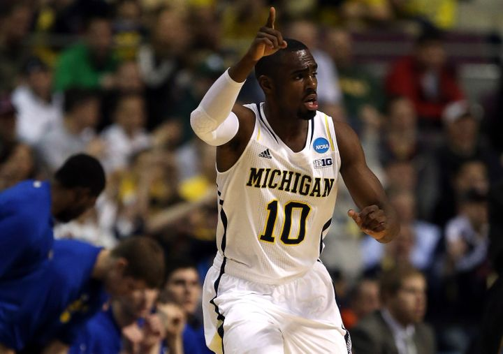 AUBURN HILLS, MI - MARCH 21:  Tim Hardaway Jr. #10 of the Michigan Wolverines reacts in the first half against the South Dako