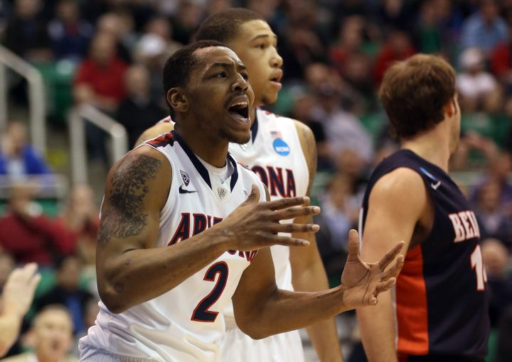 SALT LAKE CITY, UT - MARCH 21:  Mark Lyons #2 of the Arizona Wildcats reacts after a drive to the basket in the first half wh