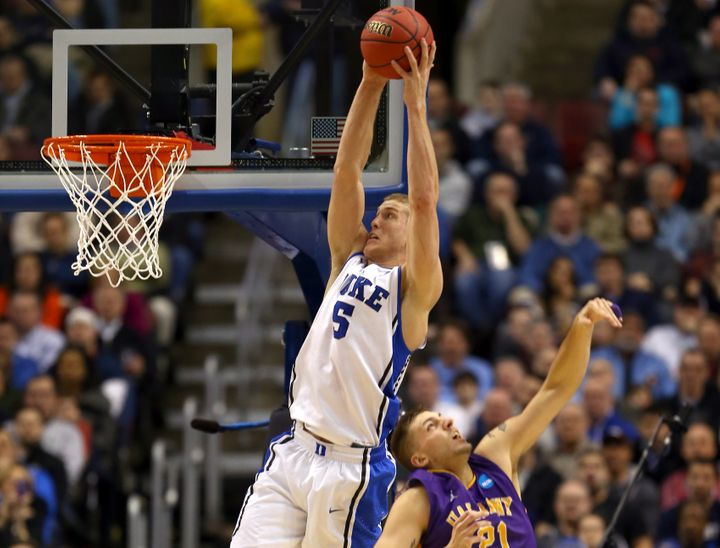 PHILADELPHIA, PA - MARCH 22:  Mason Plumlee #5 of the Duke Blue Devils catches a pass for a dunk over Blake Metcalf #21 of th
