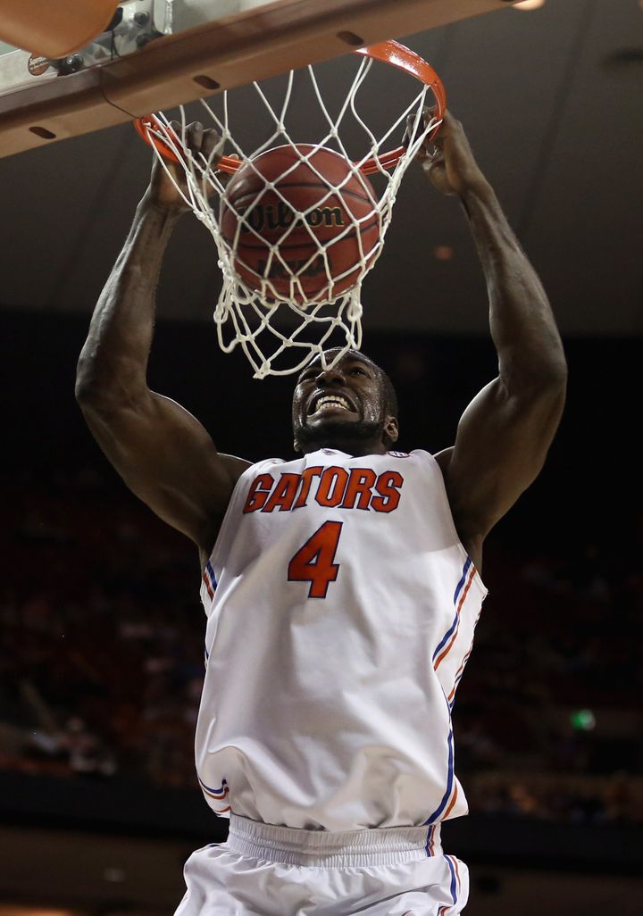 AUSTIN, TX - MARCH 22:  Patric Young #4 of the Florida Gators dunks the ball against the Northwestern State Demons during the
