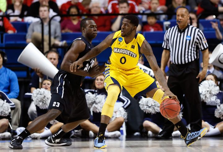LEXINGTON, KY - MARCH 23: Jamil Wilson #0 of the Marquette Golden Eagles handles the ball against Roosevelt Jones #21 of the