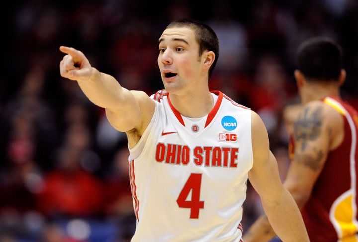 DAYTON, OH - MARCH 24: Aaron Craft #4 of the Ohio State Buckeyes gestures after a play against the Iowa State Cyclones in the