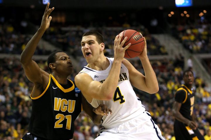 AUBURN HILLS, MI - MARCH 23:  Mitch McGary #4 of the Michigan Wolverines drives in the first half against Treveon Graham #21