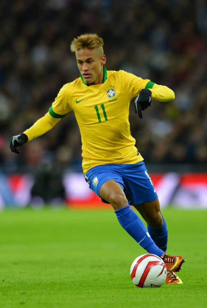 LONDON, ENGLAND - FEBRUARY 06:  Neymar of Brazil in action during the International friendly between England and Brazil at We