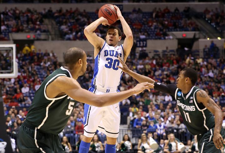 INDIANAPOLIS, IN - MARCH 29:  Seth Curry #30 of the Duke Blue Devils attempts a shot over Adreian Payne #5 and Keith Appling