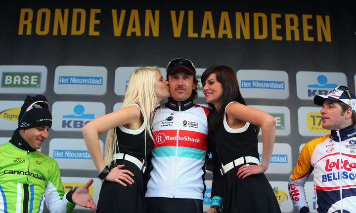 OUDENAARDE, BELGIUM - MARCH 31:  Race winner Fabian Cancellara of Switzerland and RadioShack Leopard standards on top of the