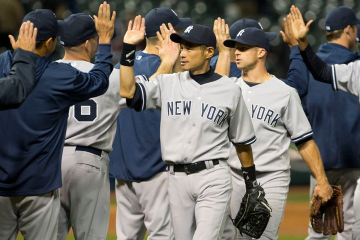 CLEVELAND, OH - APRIL 9:  Ichiro Suzuki #31 and Brett Gardner #11 of the New York Yankees celebrate after defeating the Cleve