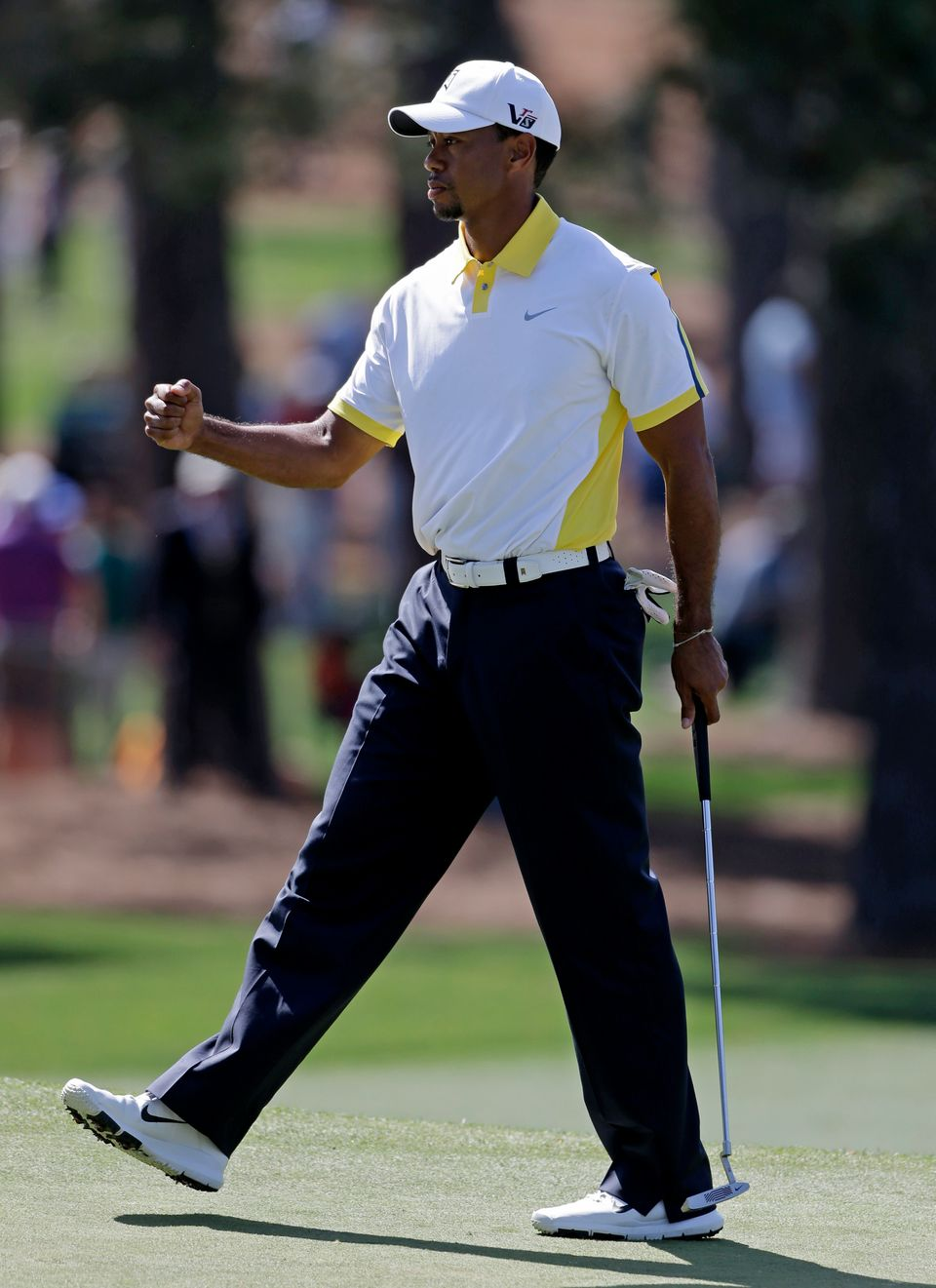 Tiger Woods pumps his fist after a birdie on the seventh hole during the second round of the Masters golf tournament Friday,