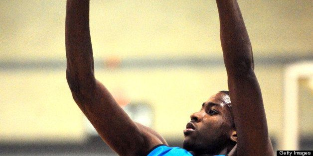 Michael Gilchrist releases a jump shot, Thursday, April 14, 2011, at the Charlotte Convention Center during practice for the