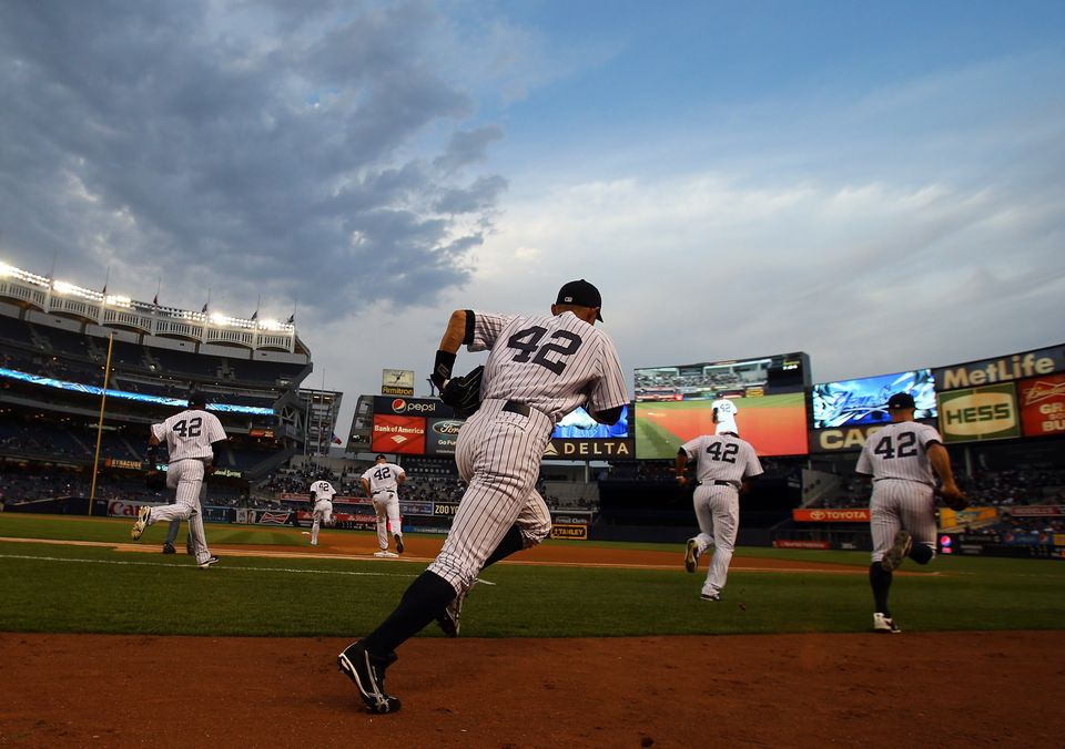 The New York Yankees run out onto the field before the game against the Arizona Diamondbacks on April 16, 2013 at Yankee Stad