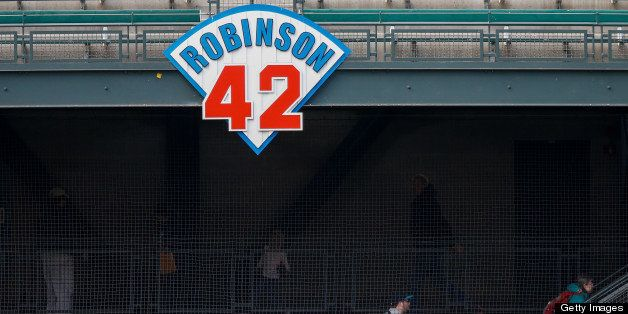 SEATTLE, WA - APRIL 16:  Fans enter the park in left field under a sign honoring Jackie Robinson prior to the game between th