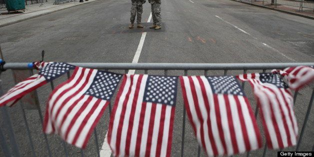 BOSTON, MA - APRIL 16: American flags on a roadblock fly in remembrance of victims of the bombing of the Boston Marathon at a