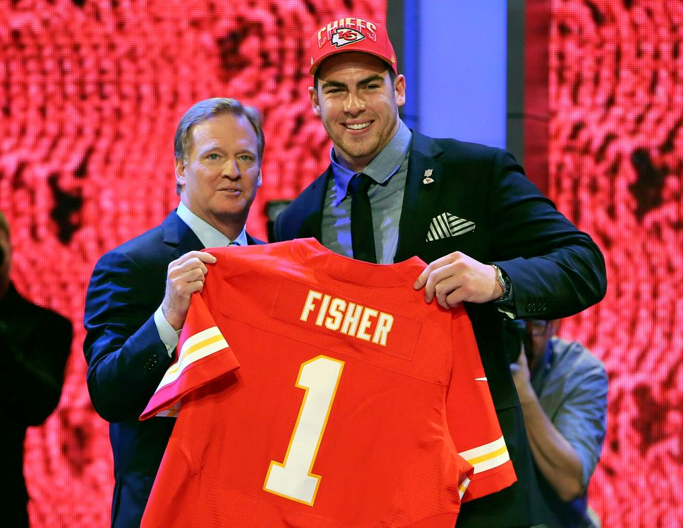 Tackle Eric Fisher from Central Michigan stands with NFL commissioner Roger Goodell after being selected first overall by the