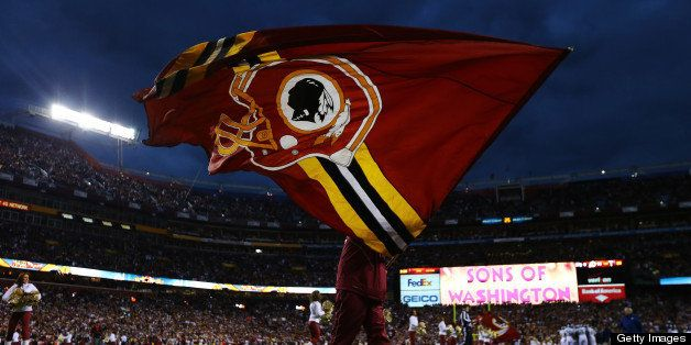 LANDOVER, MD - JANUARY 06:  A Washington Redskins flag is waved prior to the NFC Wild Card Playoff Game against the Seattle S