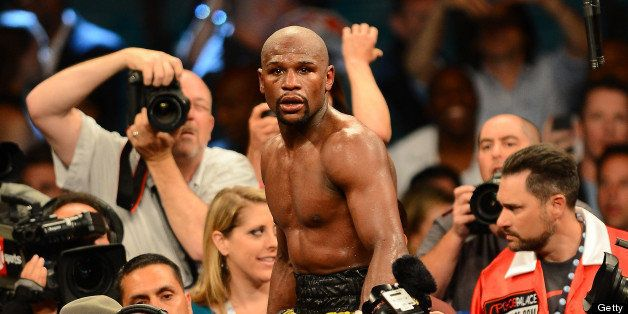 LAS VEGAS, NV - MAY 04:  Floyd Mayweather Jr. celebrates his unanimous decision victory against Robert Guerrero in their WBC