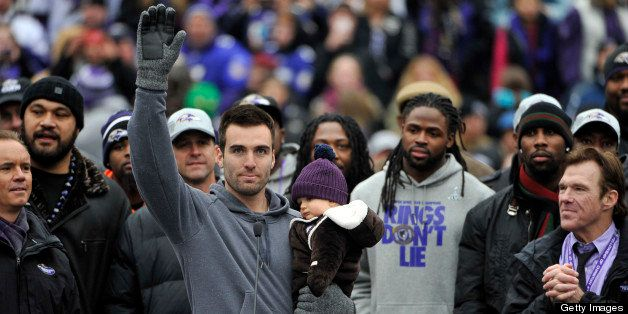 Baltimore Ravens quarterback Joe Flacco, who was named MVP of Super Bowl XLVII, waves to fans after a short speech during the