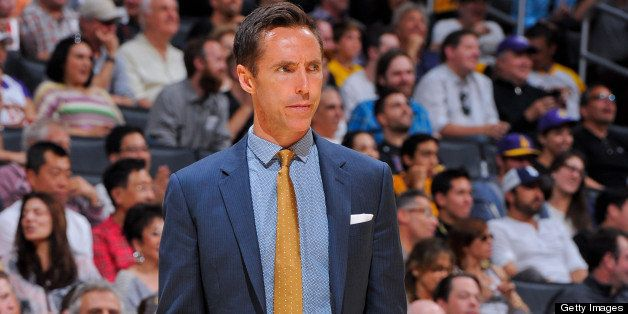 LOS ANGELES, CA - APRIL 28: Steve Nash #10 of the Los Angeles Lakers, wearing street clothes, looks on from the sideline as h