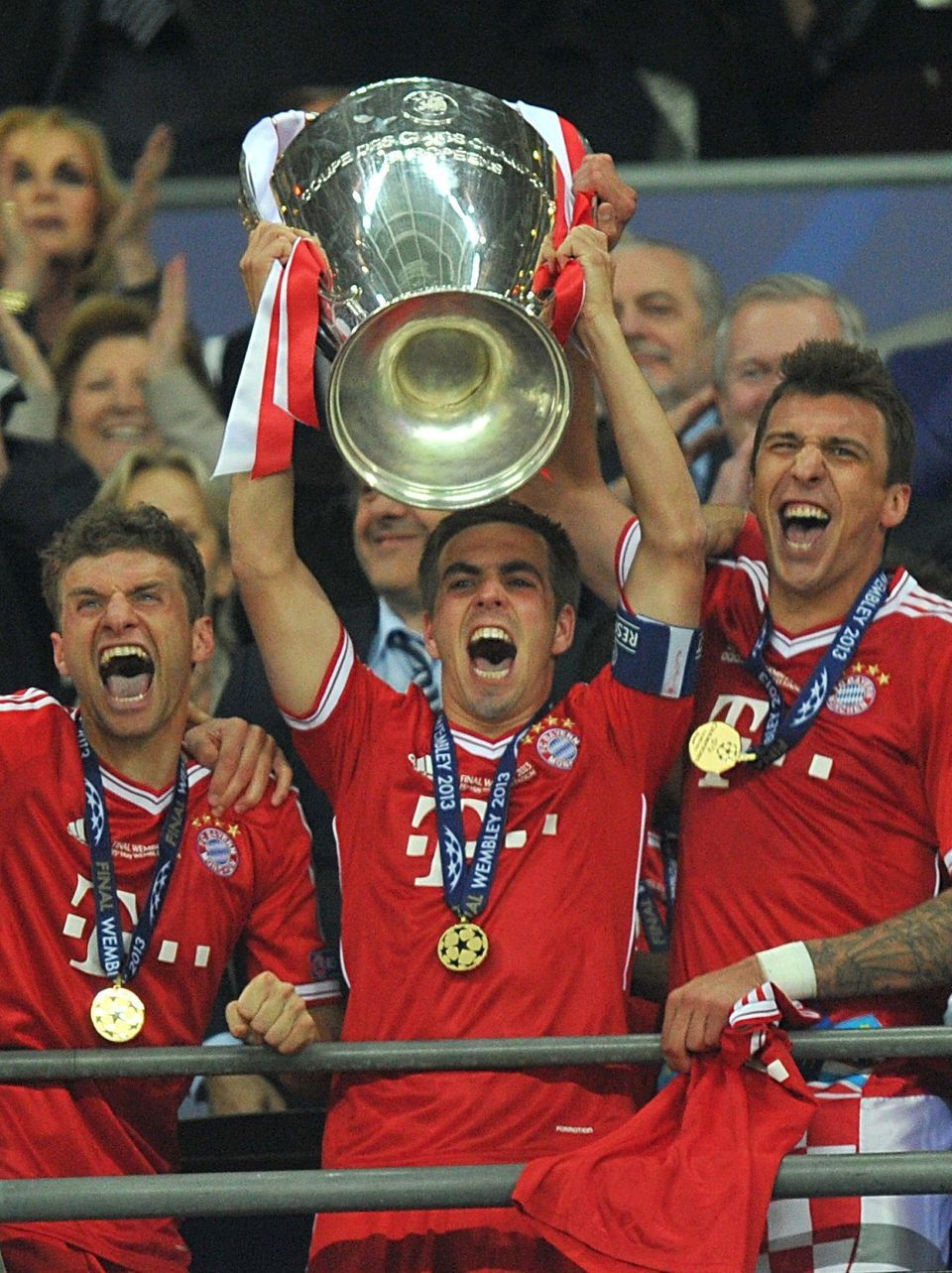Bayern Munich's Philipp Lahm lifts the UEFA Champions League trophy