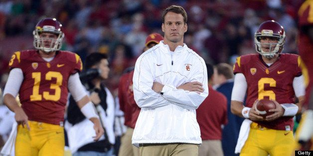LOS ANGELES, CA - NOVEMBER 24:  Head Coach Lane Kiffin of the USC Trojans walks away from Max Wittek #13 and Cody Kessler #6