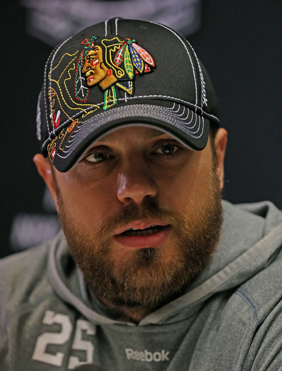 CHICAGO, IL - JUNE 11: Viktor Stalberg #25 of the Chicago Blackhawks answers questions during the 2013 NHL Stanley Cup media
