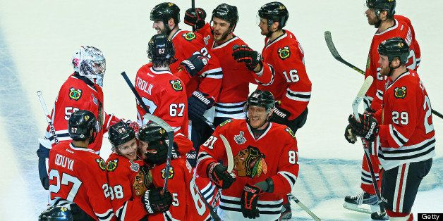 CHICAGO - JUNE 13: Blackhawks celebrate after Andrew Shaw (#65), being hugged by teammate Patrick Kane (#88) at bottom left,