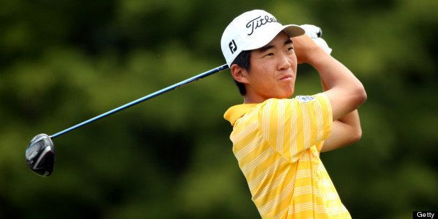 ARDMORE, PA - JUNE 11:  Amateur Michael Kim of the United States hits a tee shot during a practice round prior to the start o