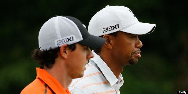 ARDMORE, PA - JUNE 14:  (L-R) Rory McIlroy of Northern Ireland and Tiger Woods of the United States walk up the tenth hole du