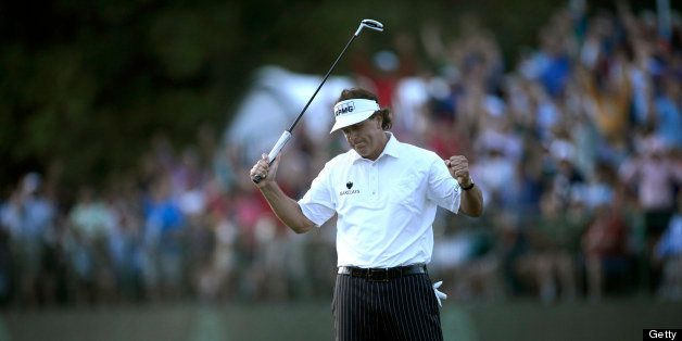 Phil Mickelson of United States reacts to his biddy putt on the 18th green finishing his second round of the US Open at Merio