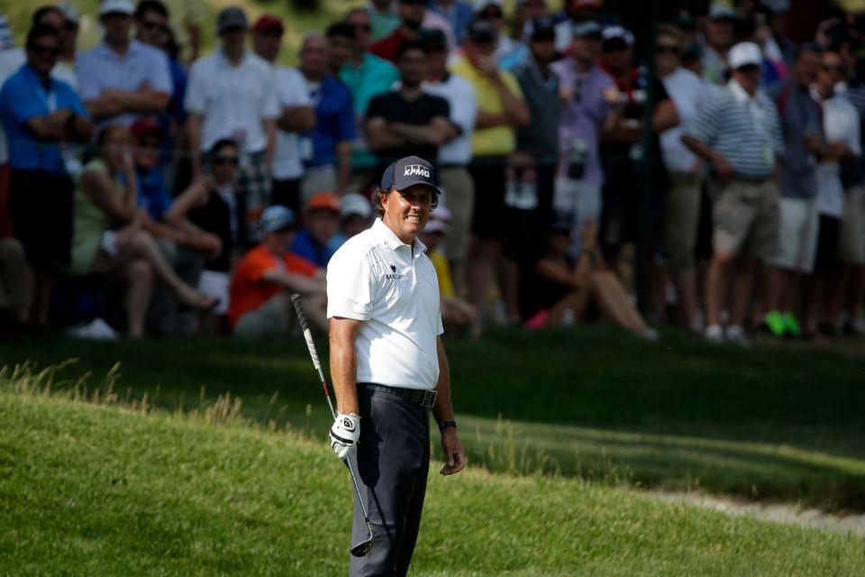 Phil Mickelson reacts to his shot on the sixth hole during the third round of the U.S. Open golf tournament at Merion Golf Cl