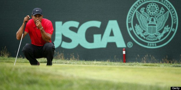 ARDMORE, PA - JUNE 16:  Tiger Woods of the United States lines up a putt on the second hole during the final round of the 113