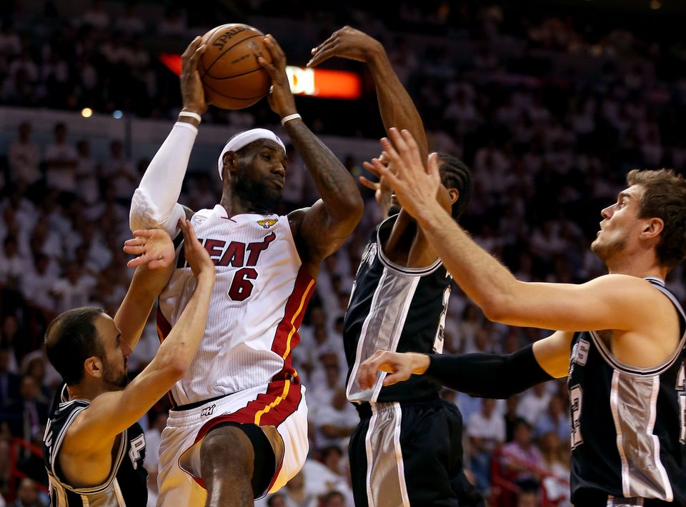 MIAMI, FL - JUNE 20:  LeBron James #6 of the Miami Heat looks to pass against Manu Ginobili #20 and Kawhi Leonard #2 of the S