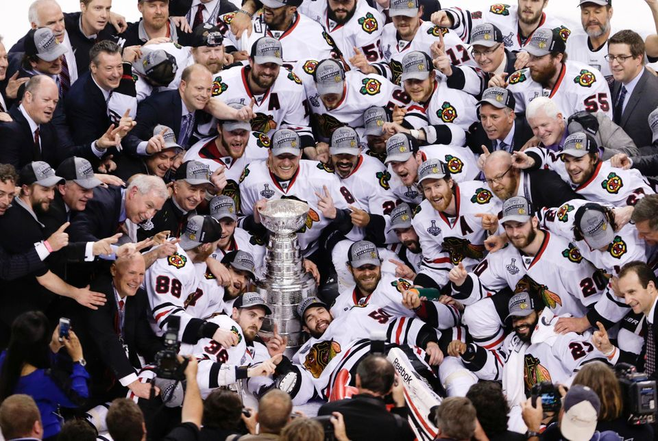 The Chicago Blackhawks pose with the Stanley Cup after beating the Boston Bruins 3-2 in Game 6 of the NHL hockey Stanley Cup