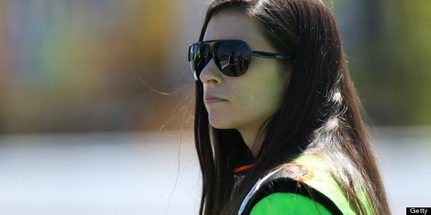 SONOMA, CA - JUNE 22:  Danica Patrick, driver of the #10 GoDaddy.com Chevrolet, stands on pit road during qualifying for the