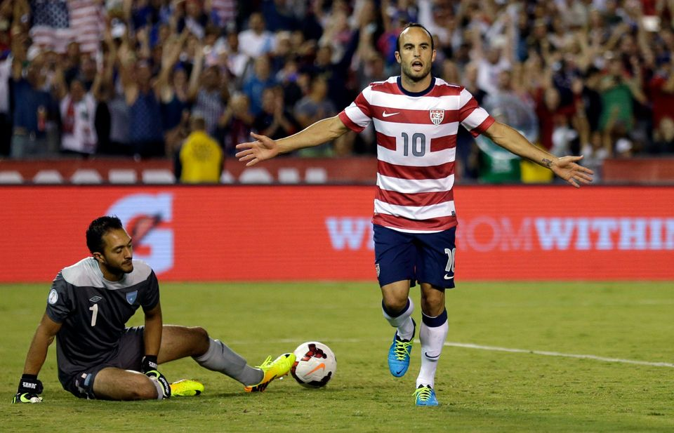 The United States' Landon Donovan, right, reacts after scoring on a penalty kick as Guatemala's goalkeeper Ricardo Jerez gets